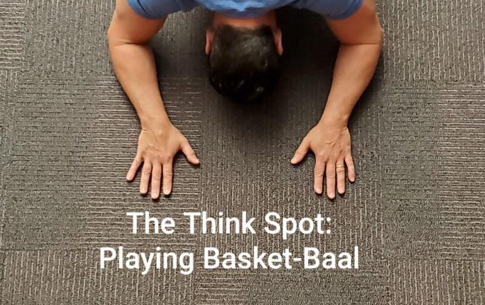 Photo of Pastor Bo Wagner kneeling before a basketball