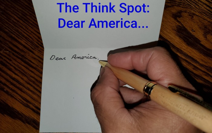Photo of Pastor Bo Wagner's hand writing a letter to America